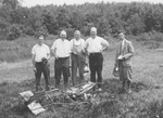 17 - Robert Goddard with crashed rocket July, 1929